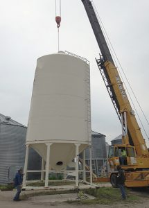 setting grain bin into place